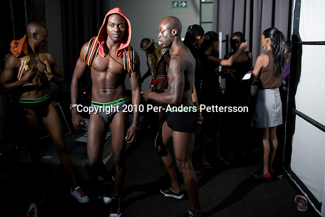JOHANNESBURG, SOUTH AFRICA - MARCH 26: Male models wait backstage before a fashion show at the South African fashion week on March 26, 2010, Turbine Hall in central Johannesburg, South Africa. Buyers and celebrities watched the 3 day fashion week, a biannual event. (Photo by Per-Anders Pettersson)