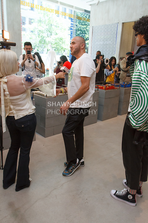 """Fashion designer Ricardo Seco being interviewed at his Ricardo Seco Spring Summer 2019 """"Vision"""" collection fashion presentation in Flying Solo, in New York City, on July 9, 2018; during New York Fashion Week: Men's Spring Summer 2019."""