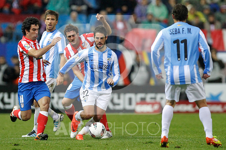 (L-R) Atletico de Madrid's Arda Turan, Koke and Malaga's Francisco Alarcon Isco  and Sebastian Fernandez during La Liga match. Mayo 5,2012. (ALTERPHOTOS/Arnedo & Alconada)