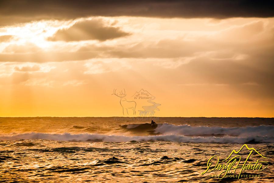 Oahu sunset, surfer, lightbeams,