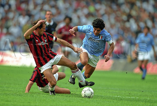21 October 1990: Maradona is tackled by Franco Baresi during the Serie A game between Napoli and AC Milan. The game finished in a 1-1 draw Photo: Mike Hewitt/Action Plus<br /> <br /> <br /> soccer football tackle 901021 foul