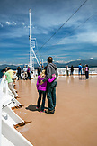 CANADA, Vancouver, British Columbia, one couple enjoys the views off the Holland America Cruise Ship, the Oosterdam, while it navigates the Seymour Narrows in the Inside Passage North of Campbell River on the way North to Ketchikan