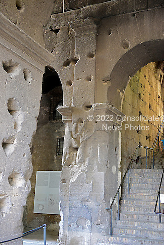 An interior column of the Colosseum, also known as the Flavian Amphitheatre, in Rome, Italy on Friday, May 25, 2012.  The holes in the columns were created by people plundering the iron clamps, which held the stone together without mortar, in the Middle Ages..Credit: Ron Sachs / CNP