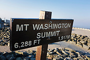 Summit sign on the summit of Mount Washington in the White Mountains, New Hampshire. Mount Washington, at 6,288 feet, is the tallest mountain in the northeastern United States.
