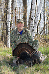 Hunter with harvested wild turkey