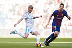 Toni Kroos (L) of Real Madrid fights for the ball with Sergio Busquets Burgos of FC Barcelona during the La Liga 2017-18 match between Real Madrid and FC Barcelona at Santiago Bernabeu Stadium on December 23 2017 in Madrid, Spain. Photo by Diego Gonzalez / Power Sport Images