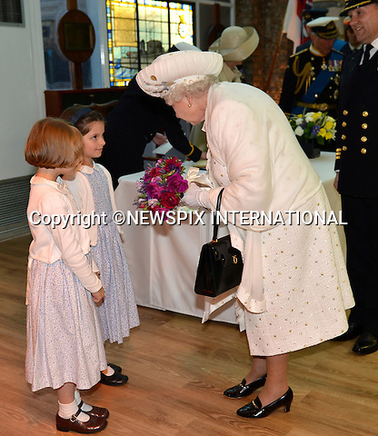 """QUEEN'S JUBILEE PAGEANT.Her Majesty The Queen receiving a Posy..London. 03/06/2012.Mandatory Credit Photo: ©B Sutton/NEWSPIX INTERNATIONAL..**ALL FEES PAYABLE TO: """"NEWSPIX INTERNATIONAL""""**..IMMEDIATE CONFIRMATION OF USAGE REQUIRED:.Newspix International, 31 Chinnery Hill, Bishop's Stortford, ENGLAND CM23 3PS.Tel:+441279 324672  ; Fax: +441279656877.Mobile:  07775681153.e-mail: info@newspixinternational.co.uk"""