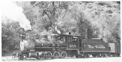 Fireman's-side view of D&amp;RGW #318 with a freight at Ouray.<br /> D&amp;RGW  Ouray, CO  Taken by Kindig, Richard H. - 6/8/1951
