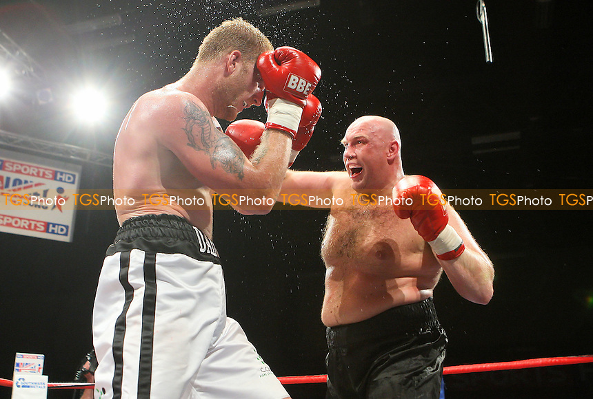 Tom Dallas (white shorts) defeats Daniil Peretyatko in a Heavyweight boxing contest at the Brentwood Centre, Essex, promoted by Frank Maloney / FTM Sports -  25/06/10 - MANDATORY CREDIT: Gavin Ellis/TGSPHOTO - Self billing applies where appropriate - Tel: 0845 094 6026