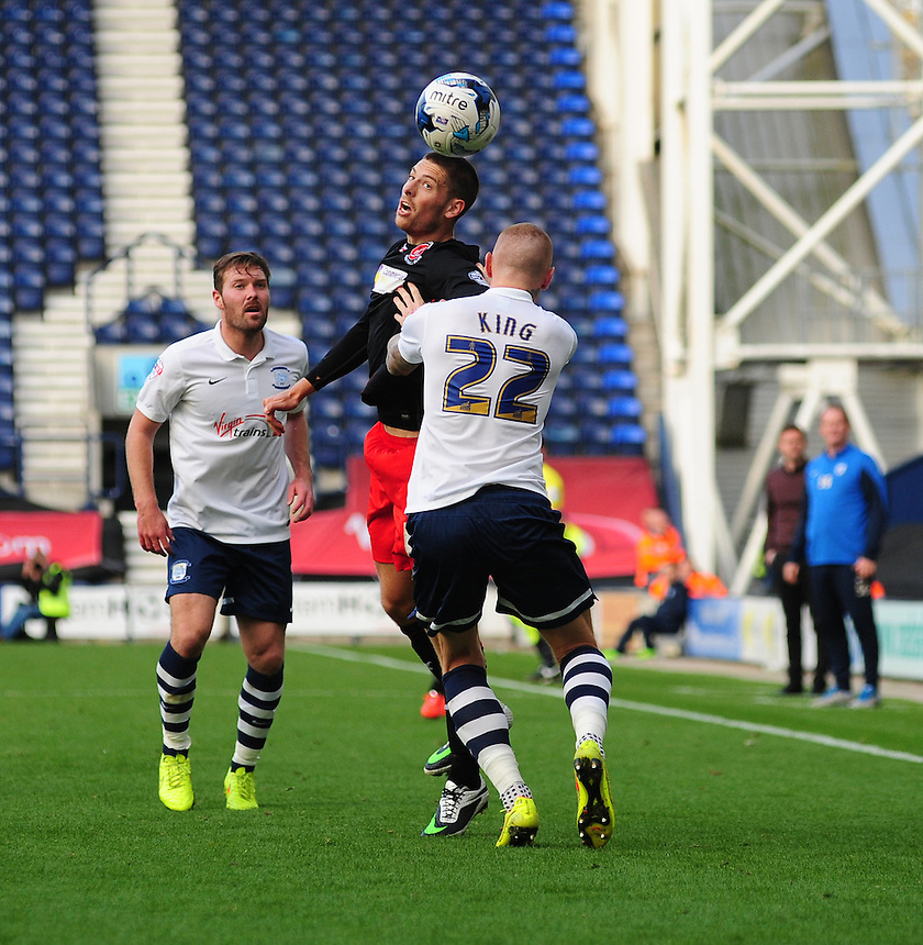 Fleetwood Town's Jamie Proctor beats Preston North End's Jack King to the ball<br /> <br /> Photographer Chris Vaughan/CameraSport<br /> <br /> Football - The Football League Sky Bet League One - Preston North End v Fleetwood Town - Saturday 25th October 2014 - Deepdale - Preston<br /> <br /> &copy; CameraSport - 43 Linden Ave. Countesthorpe. Leicester. England. LE8 5PG - Tel: +44 (0) 116 277 4147 - admin@camerasport.com - www.camerasport.com