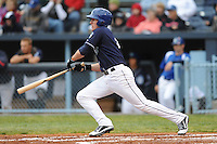Asheville Tourists Tyler Massey #7 swings at a pitch during a game against  the Lexington Legends at McCormick Field in Asheville,  North Carolina;  April 16, 2011. Lexington defeated Aheville 13-7.  Photo By Tony Farlow/Four Seam Images
