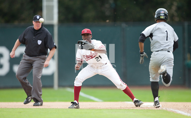 STANFORD, CA - March 27, 2011: Brian Ragira of Stanford baseball covers first to get the batter out during Stanford's game against Long Beach State at Sunken Diamond. Stanford won 6-5.