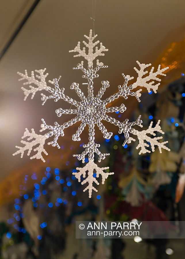 A large plastic snowflake hangs from the ceiling at the Jingle Boom Holiday Bash, which has windows decorated by artists, at the Main Street Gallery of Huntington Arts Council. Sparkboom, an HAC project, provides events such as this geared to Gen-Y to address the 'brain drain' of creative young professionals of Long Island.