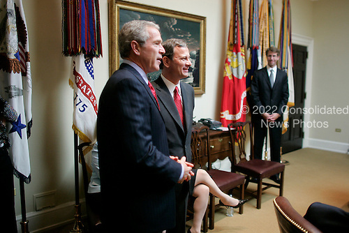 Washington, D.C. - September 29, 2005 -- United States President George W. Bush, left, and Judge John G. Roberts, Jr. watch the United States Senate vote confirming Roberts as Chief Justice of the United States in the Roosevelt Room of the White House on September 29, 2005..Credit: Paul Morse - White House via CNP