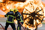 Pix: Shaun Flannery/sf-pictures.com..COPYRIGHT PICTURE>>SHAUN FLANNERY>01302-570814>>07778315553>>..4th September 2008...........Robin Hood Airport (RHA), Airport Fire and Rescue 'Blue Watch' charity calendar for Bluebellwood Childrens Hospice & Make-a-Wish..Blue WAtch tackle a fire on the airport's training rig.