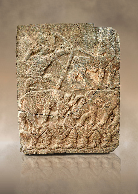 Pictures & images of the North Gate Hittite sculpture stele depicting Hittite hunting. 8th century BC. Karatepe Aslantas Open-Air Museum (Karatepe-Aslantaş Açık Hava Müzesi), Osmaniye Province, Turkey. Against art background