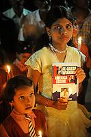 Mumbai residents takes part in a remembrance vigil next to Taj Mahal Hotel in Mumbai on the  1st of December, 2008, Mumbai, India.