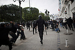"© Remi OCHLIK/IP3 - Tunis the 18 january 2011 Around Bourguiba avenue, Tunisian protestors try to demonstrate, asking for the Ben Ali party, the RDC be disolve.  Anti riots policemen spread tear gaz and beat them with their sticks.Tunisia took a step toward democracy and reconciliation Monday, promising to free political prisoners and opening its government to opposition forces long shut out of power -- but the old guard held onto the key posts, angering protesters..Demonstrators carrying signs reading ""GET OUT! demanded that the former ruling party be banished altogether -- a sign more troubles lie ahead for the new unity government as security forces struggle to contain violent reprisals, shootings and looting three days after the country's longtime president fled under pressure from the streets."