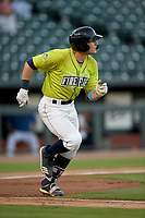 Catcher Hayden Senger (15) of the Columbia Fireflies runs toward first in a game against the Hickory Crawdads on Wednesday, August 28, 2019, at Segra Park in Columbia, South Carolina. Hickory won, 7-0. (Tom Priddy/Four Seam Images)