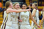 02/08/13--Milwaukie Mustangs' April Meads (10) Alexis Noren (2) and Taylor Cunningham (24) celebrate after defeating Liberty Falcons 43-40 at Milwaukie High School..Photo by Jaime Valdez.