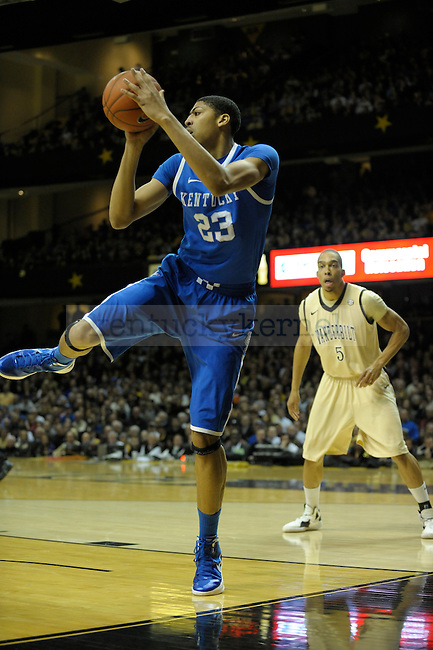 UK's forward Anthony Davis saves a ball from out of bounds during the first half of the University of Kentucky men's basketball game against Vanderbilt at Memorial Gym in Nashville, Tennessee., on Feb. 11, 2012. UK led 36-23 at half. Photo by Mike Weaver | Staff
