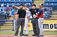 Home plate umpire Ryan Powers discusses ground rules with umpire Matt Carlyon, Asheville Tourists manager Warren Schaeffer and (13) and Hagerstown Suns manager Patrick Anderson before a game at McCormick Field on June 6, 2016 in Asheville, North Carolina. The Tourists defeated the Suns 12-10. (Tony Farlow/Four Seam Images)