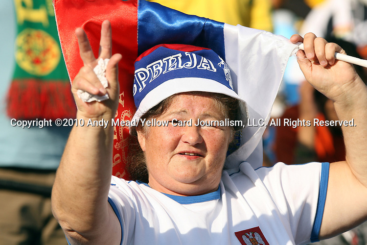 13 JUN 2010:  Serbia fan in the stands with her country's flag.  The Serbia National Team played the Ghana National Team at Loftus Versfeld Stadium in Tshwane/Pretoria, South Africa in a 2010 FIFA World Cup Group D match.