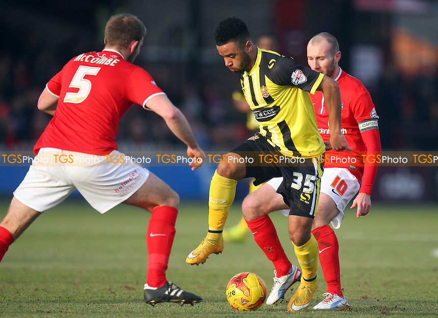 Alex Jakubiak of Dagenham and Redbridge takes on John McCombe while Russell Penn of York City watches on - York City vs Dagenham and Redbridge - Sky Bet League Two action at the Bootham Crescent Stadium on 07/02/2015 - MANDATORY CREDIT: Dave Simpson/TGSPHOTO - Self billing applies where appropriate - 0845 094 6026 - contact@tgsphoto.co.uk - NO UNPAID USE