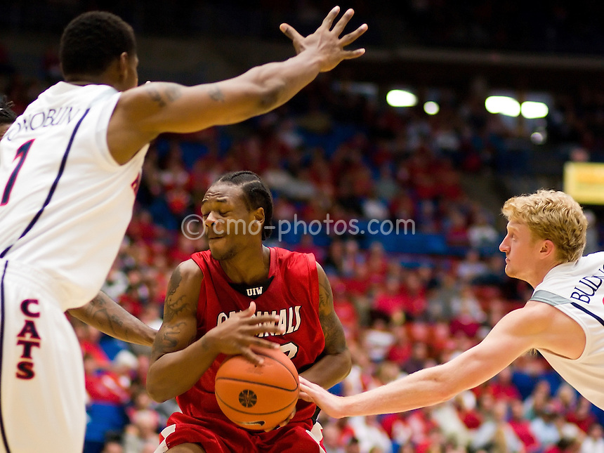 Nov 6, 2008; Tucson, AZ, USA; Arizona Wildcats forward Chase Budinger (34) and Arizona Wildcats forward Fendi Onobun (1) try to defend a Incarnate Word Cardinals player in the first half of a game at the McKale Center.  The Wildcats beat the Cardinals 97-83.