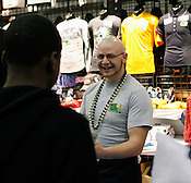 T-shirt vendor Seth Collins from Archdale enjoys the tournament. Wake Forest defeated Miami 81-74 during quarter finals of the 2012 ACC Women's Basketball Tournament at the Greensboro Coliseum in Greensboro, NC. Photo by Al Drago.