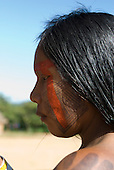 Pará State, Brazil. Aldeia Pukararankre (Kayapo). Woman with urucum and genipapo face paint.