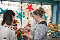 People shop at Little Luxuries on State Street on Wednesday, January 6, 2016 in Madison, Wisconsin