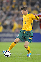 MELBOURNE, AUSTRALIA - OCTOBER 14: Jason Culina from Australia traps a ball in a AFC Asian Cup 2011 match between Australia and Oman at Etihad Stadium on October 14, 2009 in Melbourne, Australia. Photo Sydney Low www.syd-low.com