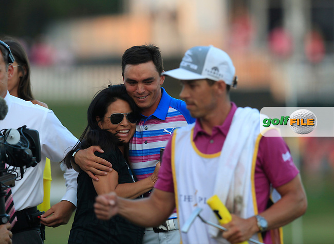 Rickie FOWLER (USA) celebrates with his mam and sister on the 17th green 4 extra playoff hole during the final round at The Players, TPC Sawgrass, Ponte Vedra Beach, Florida, United States. 10/05/2015<br /> Picture Fran Caffrey, www.golffile.ie