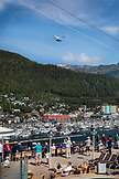 ALASKA, Ketchikan, passengers watch from deck as the cruise ship departs Ketchikan through the Clarence Straight for Juneau