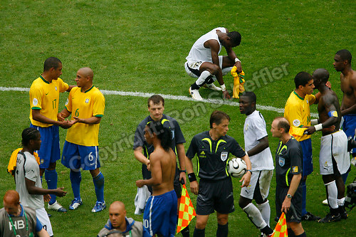 Jun 27, 2006; Dortmund, GERMANY; Ghana defender (15) John Pantsil, crouches on the field following Ghana's 3-0 loss against Brazil, as players from both teams mingle in second round action of the 2006 FIFA World Cup at FIFA World Cup Stadium Dortmund. Mandatory Credit: Ron Scheffler-US PRESSWIRE Copyright © Ron Scheffler.