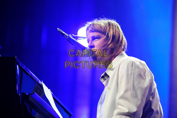Tom Odell <br /> performing in concert as part of the iTunes Festival, Camden Roundhouse, London, England, UK, 12th September 2013.<br /> music live on stage gig half length  side playing piano singing microphone white shirt <br /> CAP/MAR<br /> &copy; Martin Harris/Capital Pictures