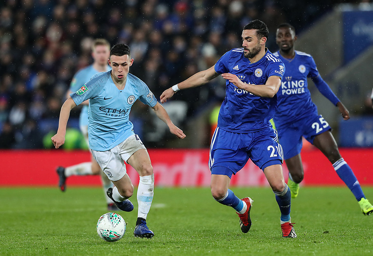 Manchester City's Phil Foden competing with Leicester City's Vicente Iborra<br /> <br /> Photographer Andrew Kearns/CameraSport<br /> <br /> English League Cup - Carabao Cup Quarter Final - Leicester City v Manchester City - Tuesday 18th December 2018 - King Power Stadium - Leicester<br />  <br /> World Copyright © 2018 CameraSport. All rights reserved. 43 Linden Ave. Countesthorpe. Leicester. England. LE8 5PG - Tel: +44 (0) 116 277 4147 - admin@camerasport.com - www.camerasport.com