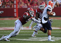 NWA Democrat-Gazette/ANDY SHUPE<br /> Arkansas' Josh Williams (left) reaches to tackle University of Texas at El Paso's Jeremiah Laufasa Saturday, Sept. 5, 2015, during the third quarter of play in Razorback Stadium in Fayetteville. Visit nwadg.com/photos to see more from the game.
