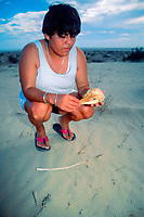 researcher, holding skull of vaquita, Phocoena sinus, which died after being trapped in a fishing net, critically endangered species, endemic to the northernmost portion of the Sea of Cortez, Gulf of California, El Golfo, Mexico, Pacific Ocean