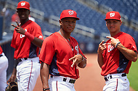 GCL Nationals Andry Arias (left), Jaylen Hubbard (center), Allan Berrios (right) before a Gulf Coast League game against the GCL Mets on August 12, 2019 at FITTEAM Ballpark of the Palm Beaches in Palm Beach, Florida.  GCL Nationals defeated the GCL Mets 7-3.  (Mike Janes/Four Seam Images)