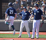 Marquette's George Williams (left) leaps in the air in jubilation after crossing home plate and is greeted by teammates Hunter Miller (center) and Connor Throneberry. Marquette defeated CBC in the Class 5 baseball sectional played at Vianney High Schoo lin St. Louis, MO on Wednesday May 22, 2019.<br /> Tim Vizer/Special to STLhighschoolsports.com