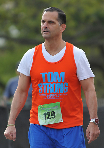 Joe Miloscia gets ready to participate in the inaugural 1-mile race as part of Long Island Marathon Weekend at Eisenhower Park on Saturday, May 5, 2018. He and family members ran to honor the memory of his son, Thomas Matthew Miloscia, who died of an aggressive form of cancer in October 2015 at the age of 18. The Thomas Matthew Miloscia Foundation has since been founded in order to support families with members battling the illness.