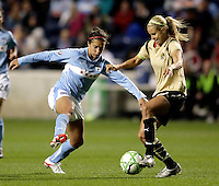 Chicago Red Star midfielder Carli Lloyd (10) tries to intercept a pass by FC Gold Pride midfielder Leslie Osborne (10).  The defeated the FC Gold Pride defeated the Chicago Red Stars 1-0 at Toyota Park in Bridgeview, IL on May 16, 2009.