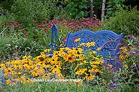 63821-21701 Blue bench & butterfly house in flower garden.  Black-eyed Susans (Rudbeckia hirta) Raspberry Wine Bee Balm (Monarda didyma)  Marion Co., IL