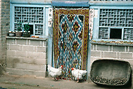 September, 1985. Shaanxi Province, China. Colorful entrances of cave houses in Yan'an.