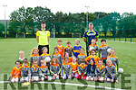 Coach Paul McMahon and Aaron Murphy with kids at the Cúl Camp at St Pat's GAA Club on Friday