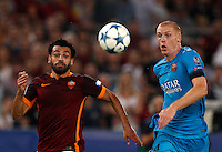Calcio, Champions League, Gruppo E: Roma vs Barcellona. Roma, stadio Olimpico, 16 settembre 2015.<br /> Roma's Mohamed Salah, left, and FC Barcelona's Jeremy Mathieu compete for the ball during a Champions League, Group E football match between Roma and FC Barcelona, at Rome's Olympic stadium, 16 September 2015.<br /> UPDATE IMAGES PRESS/Riccardo De Luca