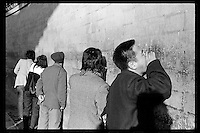 A Chinese visitor yells as others listen at the Echo Wall or The Whispering Wall inside the Temple of Heaven in Beijing, China, 1985. The ancient wall is 3.72 meters high, 90 centimeters thick and 65.1 meters in diameter.