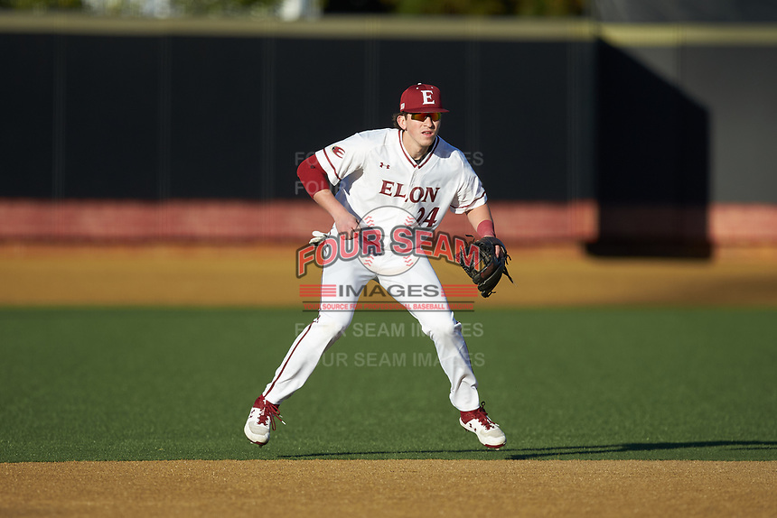 Elon Phoenix shortstop Cam Devanney (24) on defense against the Quinnipiac Bobcats at David F. Couch Ballpark on February 24, 2019 in  Winston-Salem, North Carolina. (Brian Westerholt/Four Seam Images)